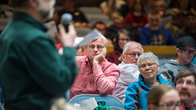 Wendell Farrell listens to debate during Jericho's town meeting at Mt. Mansfield Union High School on Tuesday, March 7, 2017.