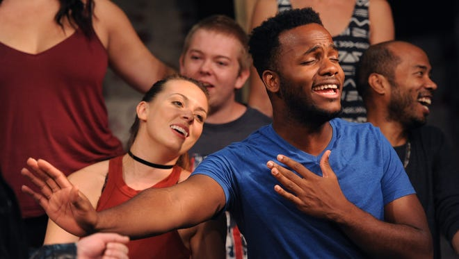 """Deon'te Goodman, playing the role of Tom Collins, sings as he and cast members rehearse a scene for the upcoming North Street Playhouse production of """"Rent"""" on Wednesday, July 13, 2016. The show opens on Thursday, July 21."""