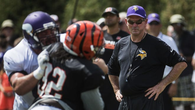 Minnesota Vikings head coach Mike Zimmer, right, watches from the sidelines on Wednesday during a joint practice with the Cincinnati Bengals in Cincinnati.