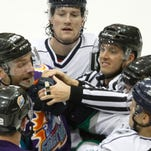 Everblades defender Jordan Henry, top, watches a fight between his teammates and the Orlando Solar Bears Friday at Germain Arena.