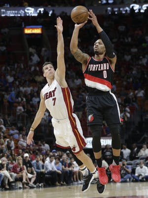 Damian Lillard, here shooting over the Miami Heat's Goran Dragic, and the Portland Trail Blazers will resume the 2019-20 season on July 31.