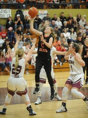 Ira's Alyssa Goodwon (12) drives to the basket while