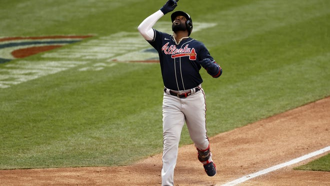 Atlanta Braves designated hitter Marcell Ozuna celebrates a solo home run against the New York Mets during the ninth inning of a game Saturday in New York. The Braves won 5-3 in 10 innings. The teams' game scheduled for Sunday night was not over at press time.