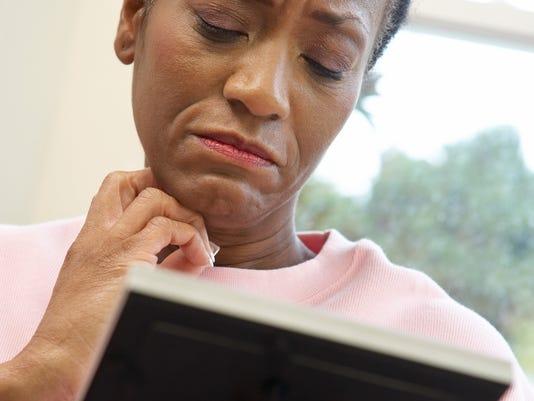 Woman gazing at photo
