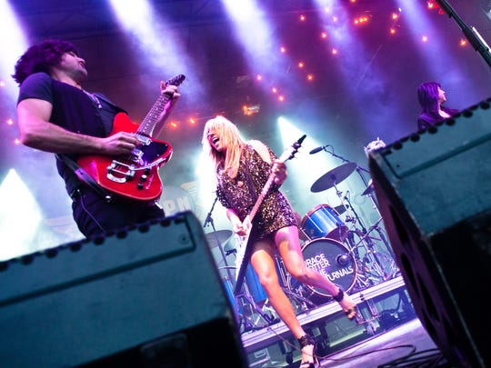 Scott Tournet (left) performs with Grace Potter and the Nocturnals during the 2011 Grand Point North festival in Burlington.
