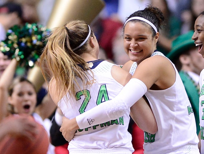 #24 Hannah Huffman is hugged during the Notre Dame celebration at the end game at the Women's Final Four in Bridgestone Arena, Sunday, April 6, in Nashville, Tenn.