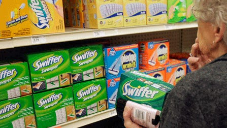 A shopper in Omaha, Neb., checks out Swiffer products. The U.S. textile industry is making a small resurgence making yarns and fibers for products such as Swiffer, diapers and towels.
