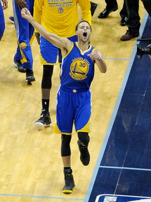 Golden State Warriors guard Stephen Curry (30) reacts after making a 62-foot three point shot at the buzzer to end the third quarter against the Memphis Grizzlies in game six of the second round of the NBA Playoffs at FedExForum. Golden State Warriors beat Memphis Grizzlies 108-95.