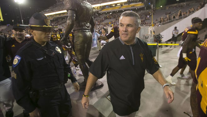 ASU head football coach Todd Graham walks off the field after ASU's 37-35 win over Oregon in the  PAC-12 college football game at Sun Devil Stadium in Tempe on Saturday, September 23, 2017.