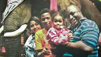 FILE - In this undated family file photo provided by the National Action Network, Eric Garner, right, poses with his children during a family outing. According to a lawyer for the victim's family, a New York City grand jury on Wednesday, Dec. 3, 2014 cleared a white police officer in the videotaped chokehold death of the unarmed Garner, who had been stopped on suspicion of selling loose, untaxed cigarettes. (AP Photo/Family photo via National Action Network, File)