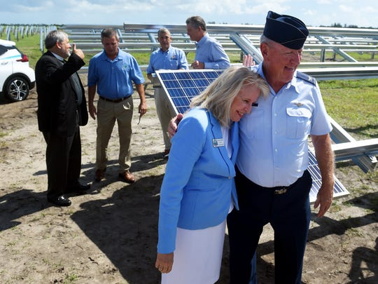 Vero Beach Mayor Laura Moss hugs retired Air Force Lt. Col. Martin Zickert after helping to install the first solar panel at Florida Power & Light's Blue Cypress Solar Energy Center on Monday, July 10, 2017, west of Vero Beach. The 432-acre site will produce 74.5 megawatts of energy, enough to power about 15,000 homes. The Blue Cypress site is one of three solar energy centers that are planned for the Treasure Coast.