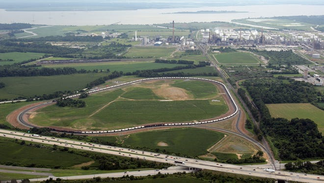 Land bordering the Delaware City Refinery is part of a new, $4 million sewer project by New Castle County officials. Government leaders said the sewer will allow for further industrial development of the area.