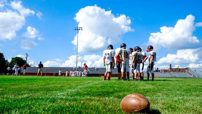 Pleasant's football team goes through a practice. The high school football season kicks off Friday night around the area.