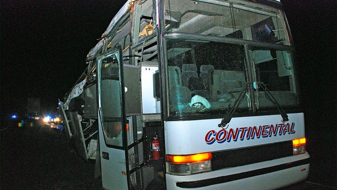 A motor coach sits in a lot following a Nov. 2016 accident that left six migrant farm workers dead and seven injured. The H-2A guest workers were on their way back to Mexico when the bus hit a concrete support on Interstate 40 in North Little Rock.