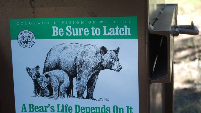 Bear-proof trash bins at Dowdy Lake Campground in Red Feather Lakes caution campers to help save a bear's life by properly disposing of garbage. The town of Estes Park is requiring residents to use wildlife-resistant trash receptacles.