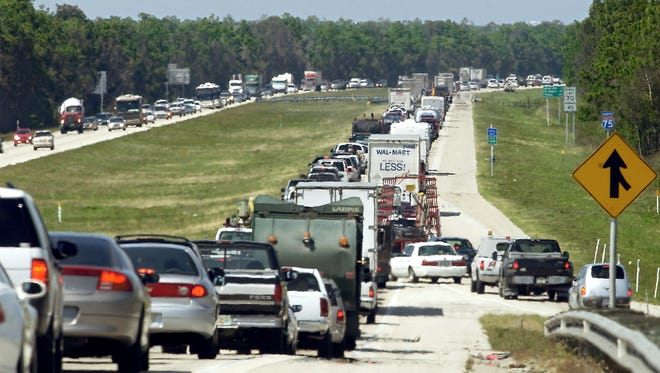 A stream of traffic merges off the Corkscrew Road entrance ramp onto a congested Interstate 75 running through Estero in 2004.