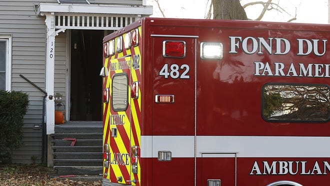 A Fond du Lac Fire/Rescue vehicle sits outside 120 East Second Street on Wednesday after they were called to the house for a 3-month-old child that was unresponsive and not breathing.