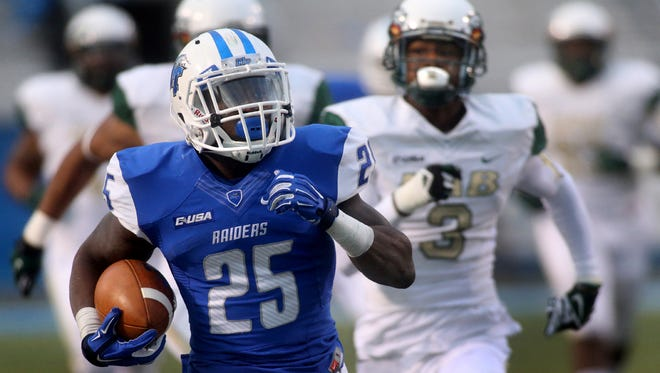 UAB's Lamarcus Farmer gives chase as MTSU's Reggie Whatley runs 67 yards for a touchdown in the fourth quarter Saturday.