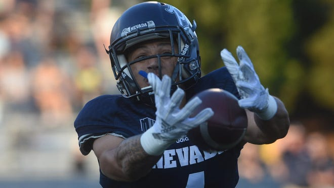 Nevada's Elijah Cooks attempts to haul in a pass against Portland State last week.