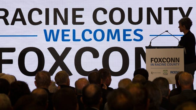 Jenny Trick, executive director of Racine County Economic Development Corp. announces the location of the Foxconn plant during a news conference Wednesday, October 4, 2017 at the SC Johnson iMET Center in Sturtevant, Wis. The site for Foxconn Technology Group's $10 billion, 20-million-square-foot electronics factory was announced at the event.  MARK HOFFMAN/MILWAUKEE JOURNAL SENTINEL