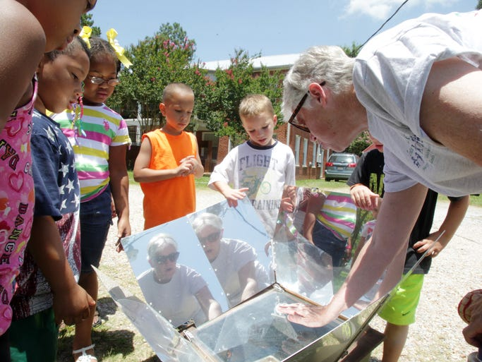 Sister Bonnie Kearney teaches five-year-olds in the Thensted Renaissance Program about solar energy by baking cookies in a sun oven Friday, July 11, 2014, at the Thensted Center in Grand Coteau, La.