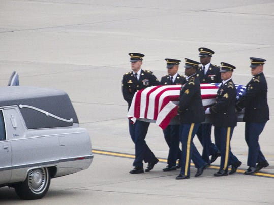 The remains of Army Cpl. Martin King are transferred to a hearse at Harrisburg International Airport Sunday.