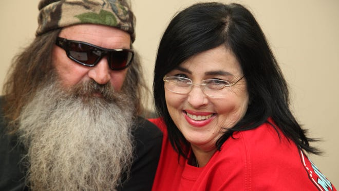 Duck Dynasty's Phil and Kay Robertson speak with media recently before a Week of Welcome event at the University of Louisiana at Monroe. The function was hosted by the Warhawks for Christ organization.