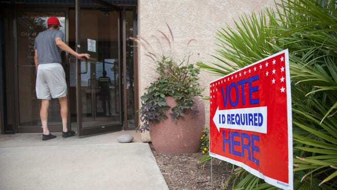 St. George residents vote at the St. George Parks Division Tuesday, June 28, 2016.