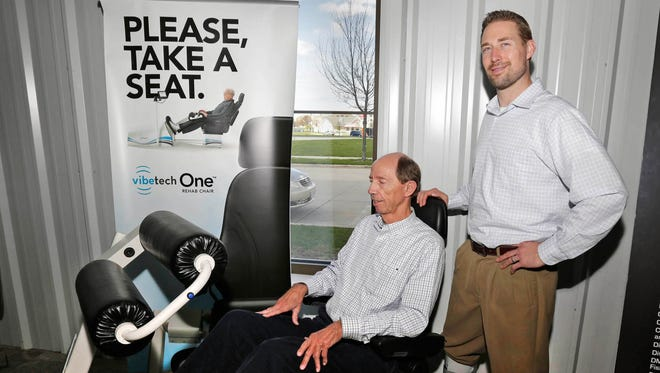 VibeTech CFO Ed Morgan, seated, tests out the a VibeTech chair as CEO and founder Jeff Leismer looks on.