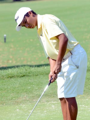 Hendersonville High senior Charles Seals tracks his putt during a match earlier this year. Seals signed a letter-of-intent to play at Tennessee Tech.