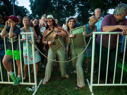 Meredith Hall, middle left, and Kristin Chester of Sturgis, Ky.    dance in the front row with their own washboards as Chubby Carrier & The Bayou Swamp Band perform during the W.C. Handy Blues and Barbecue Festival at Audubon Mill Park on Thursday, June 14, 2018.