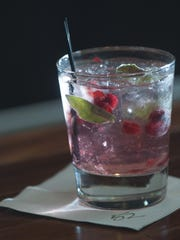 A cranberry sage cocktail is a winter warmer at Seasons 52 in Cherry Hill.