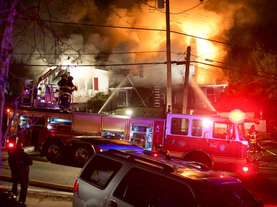 Firefighters attempt to put out a fire at 174 Boulevard