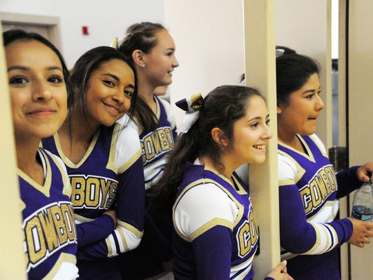 Salinas High cheerleaders watch the rally after performing on Thursday.
