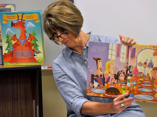 "Penny Parker Klostermann reads from her new book ""A Cooked-Up Fairy Tale,"" to a fourth-grade class at Jackson Elementary Wednesday Aug. 30, 2017. It is her second children's book after her 2015 release of ""There Was an Old Dragon Who Swallowed a Knight."""