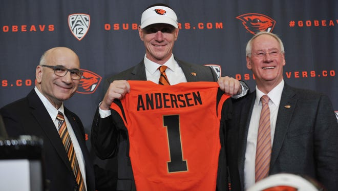 Nov 15, 2014; Corvallis, OR, USA; Oregon State Beavers new football coach Gary Andersen (center) poses for a photo with athletic director Bob De Carolis (left) and president Edward Ray during a press conference at Reser Stadium.