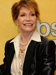 Mary Tyler Moore poses with her Life Achievement Award from the Screen Actors Guild backstage at the 18th Annual Screen Actors Guild Awards at The Shrine Auditorium on January 29, 2012 in Los Angeles.