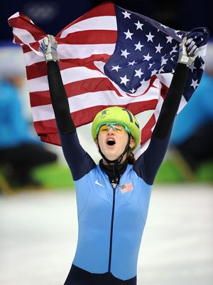 Katherine Reutter of the United States celebrates a silver medal in the 1,000-meter short track speed skating final Feb. 26, 2010, at the 2010 Vancouver Winter Olympics in Vancouver, Canada.