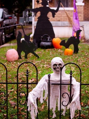 A ghost greets passers-by through a fence at 108 Hillcrest Ave. in Louisville.