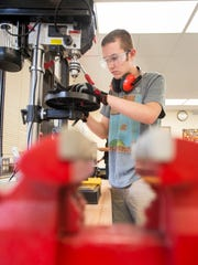Jonah Thrasher, 16, works on a drill press during manufacturing class at Milton High School on Monday, December 4, 2017.  The Santa Rosa County School District would like to create an Innovation High School to prepare students for future work and careers in fields such as cybersecurity, IT, aerospace and engineering.