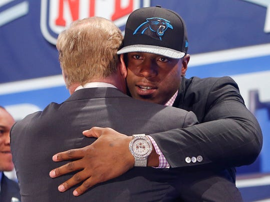 Missouri defensive end Kony Ealy hugs NFL commissioner Roger Goodell after being selected as the 60th pick by the Carolina Panthers in the second round of the 2014 NFL Draft, Friday, May 9, 2014, in New York. (AP Photo/Jason DeCrow)