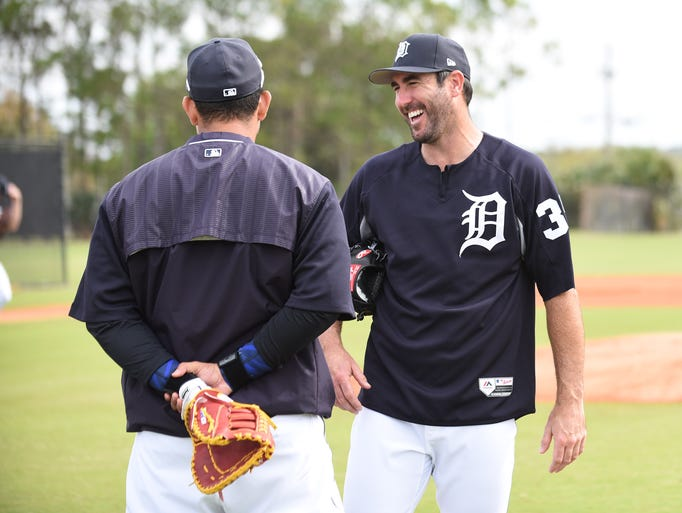 Tigers pitcher Justin Verlander, right, smiles while