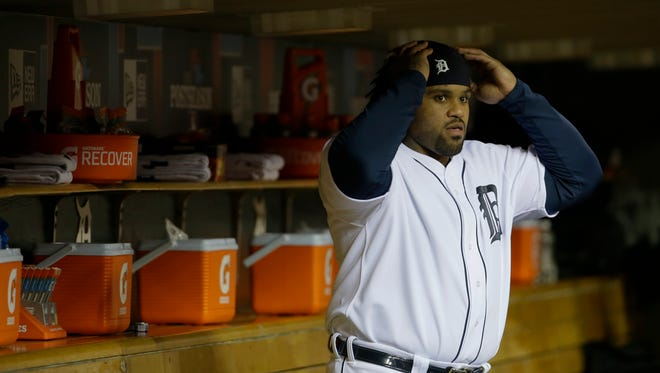 Detroit Tigers first baseman Prince Fielder gets ready in the dugout before the start of Game 5 of the American League baseball championship series against the Boston Red Sox, Thursday, Oct. 17, 2013, in Detroit.