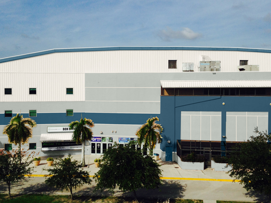 "Germain Arena staff has proposed a new paint job for the indoor stadium. Estero Design Review Board members compared the blue accent color to a ""racing stripe"" and asked Germain staff to reconsider it."