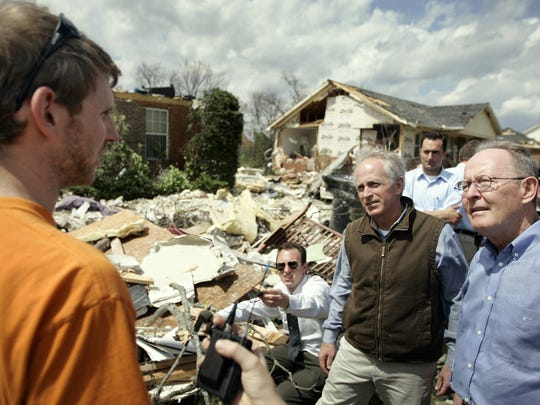 Sens. Bob Corker and Lamar Alexander talk with resident Philip Smith about the damage to his home during a tour of tornado damage in Murfreesboro on April 13, 2009.