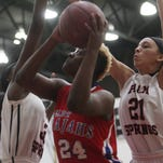 At far left, Palm Springs High School's Anastasia Reagins and Joana Adams defend Indio High School's Dneesya Baxter during their game in Palm Springs. Palm Springs won the game 37-29 and finished DVL in a tie with Indio High School.