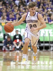 Lexington point guard Mason Kearns dribbles downcourt during the state semifinals against Akron St. Vincent-St. Mary