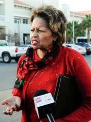 County Manager Julia Brown speaks to the media after