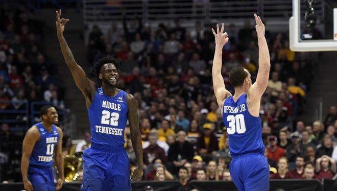 MTSU forwards Reggie Upshaw (30) and JaCorey Williams (22) celebrate after a shot against the Minnesota during the first half of the NCAA tournament game at BMO Harris Bradley Center on March 16, 2017.