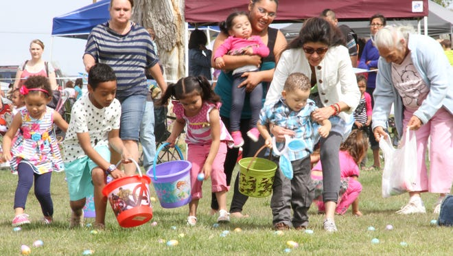 Alamogordo's Easter in the Park went off without a hitch at Alameda Park Saturday. The Easter egg hunt had about 400 children running for plastic eggs that contained candy or a small trinket. If a child found an egg with a dot on it, they won an Easter basket filled with candy and other Easter related items.